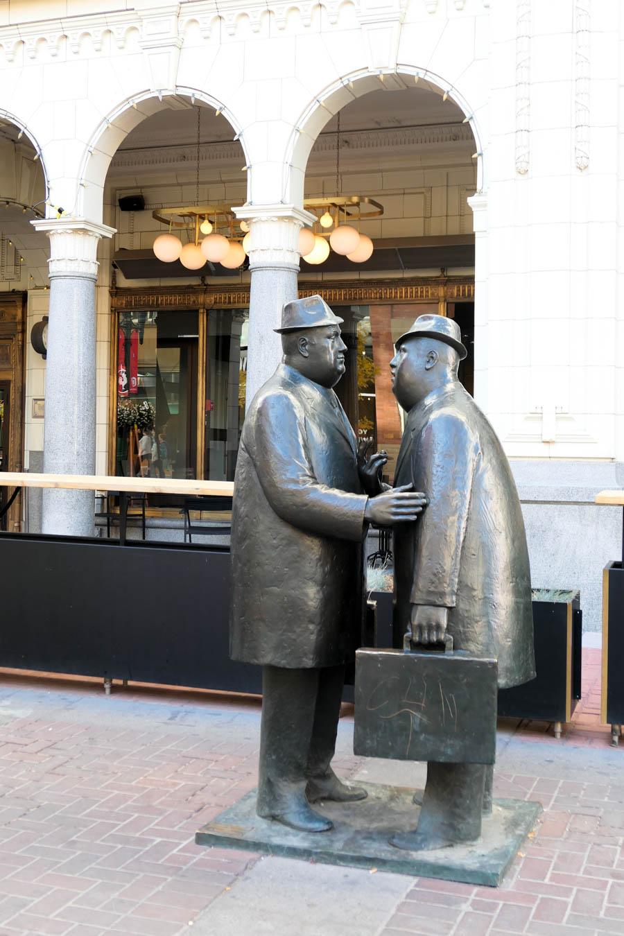 Men Meeting in the Street Statue in Calgary