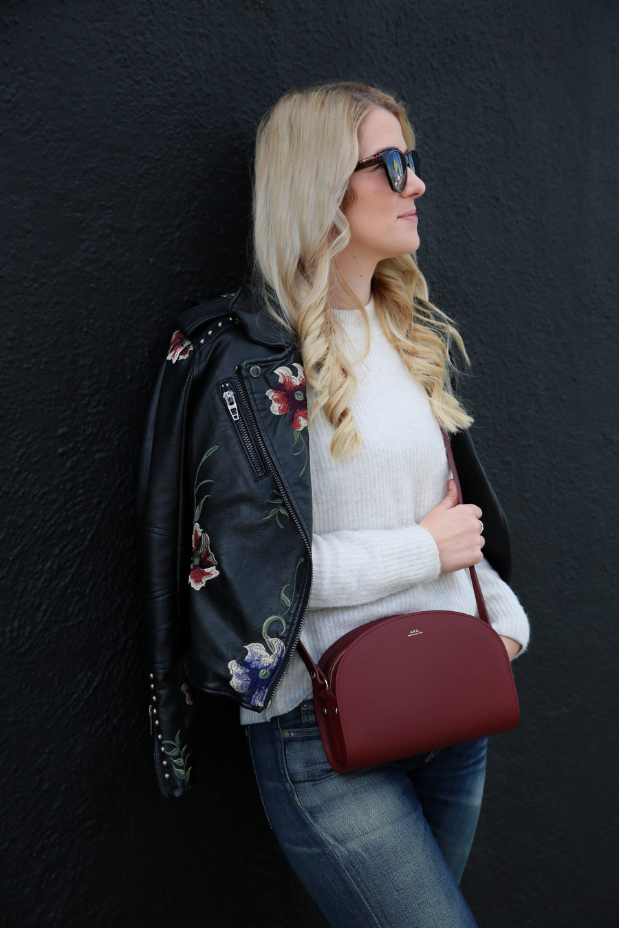 Black Sneakers Outfit for Women with Jeans + Leather Jacket