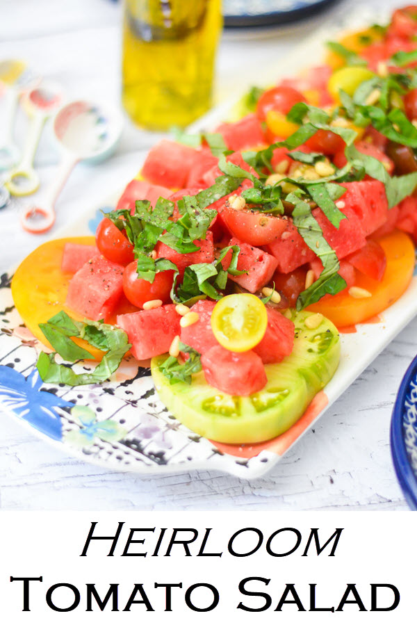 Heirloom Tomato Salad. A perfect summer salad with heirloom tomatoes and watermelon. A delicious salad to serve guests on a warm evening. Great salad for potlucks and bbqs.