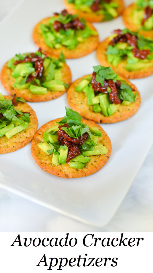 Avocado Cracker Appetizers. Sun-Dried Tomato Avocado Cracker Topping - Easy Appetizer Recipe. Easy appetizer recipe with avocado. #appetizer #appetizers #starters #entertaining #dinnerparty #avocado #sundried #foodblog #lmrecipes