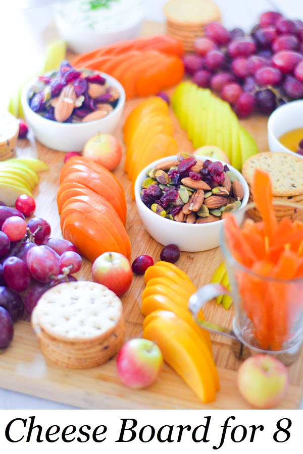 Fruit and Cheese Appetizer Board for 8 People. Featuring trail mix, sliced fresh fruit, herbed goat cheese, and crackers. #appetizer #entertaining #cheeseboard #foodblog #appetizer #freshfruit