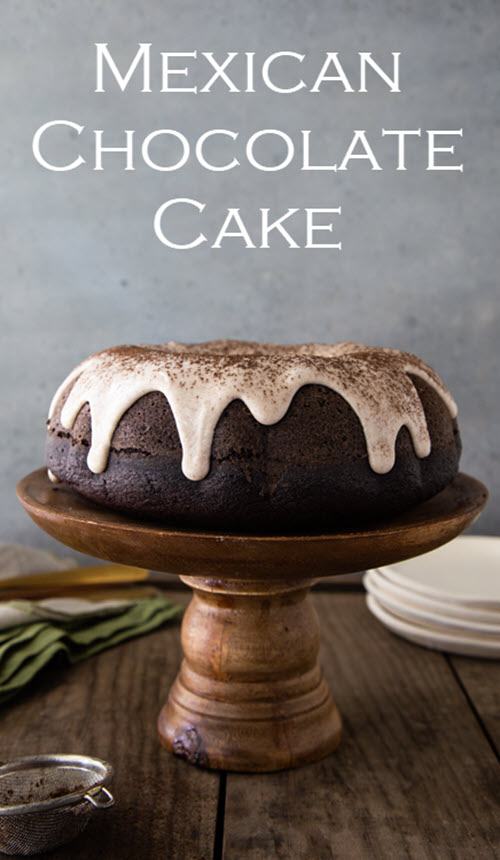 Mexican Chocolate Cake with Cinnamon Glaze. This delicious chocolate cake from scratch recipe is a family pleaser. The cinnamon and Mexican spices have a delicious, warm feeling that will win over everyone! #cake #mexicanchocolate #chocolatecake #homemade #bundtcake #lmrecipes