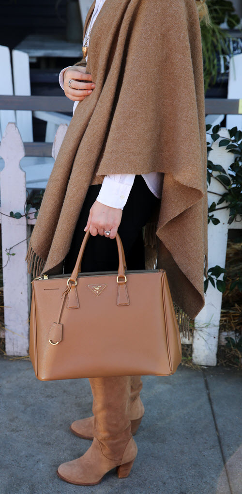 Tan Cape Outfit Idea with Boots + Button Down Shirt. Prada Saffiano Tote w. Suede Boots and Shawl.
