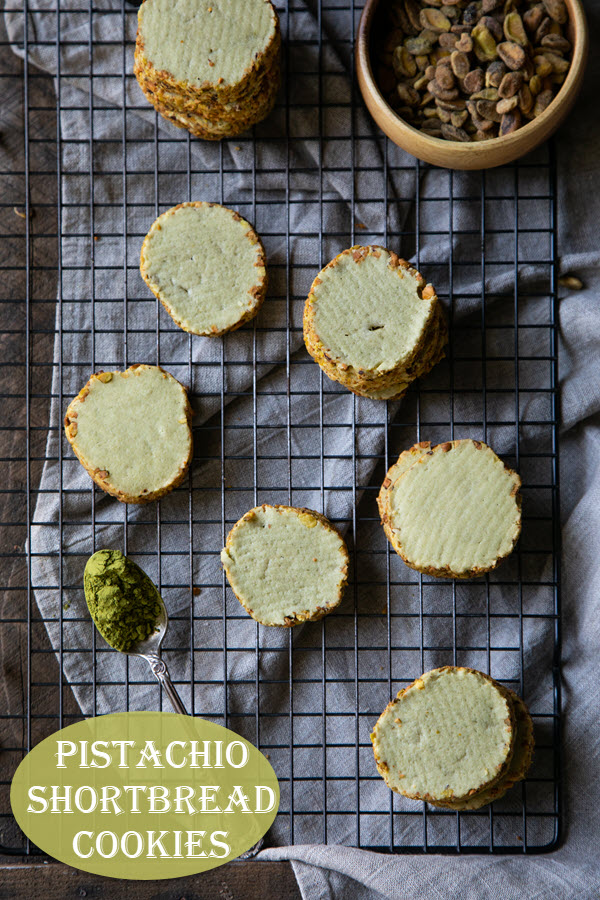 Pistachio Shortbread Cookies. These butter cookies are rolled in chopped pistachios with a hint of matcha powder for a slightly green color. Tasty cookies to serve with afternoon tea, ice cream, or coffee! #lmrecipes #cookies #pistachios #buttercookies #baking #shortbread #dessert