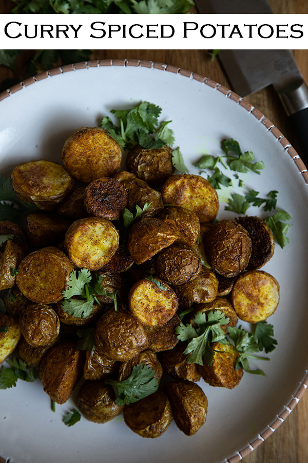 Curry Spiced Potatoes. Mix delectable roasted potatoes with curry spices for a tasty spin on a traditional American and Indian dish. #lmrecipes