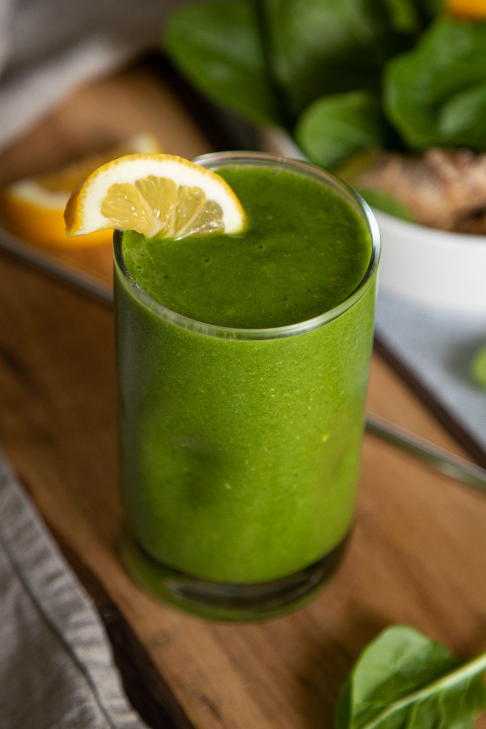 Close up Photo of Ginger Spinach Smoothie with half Lemon slice