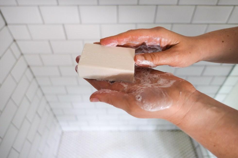 Sudsy shampoo bar in hand