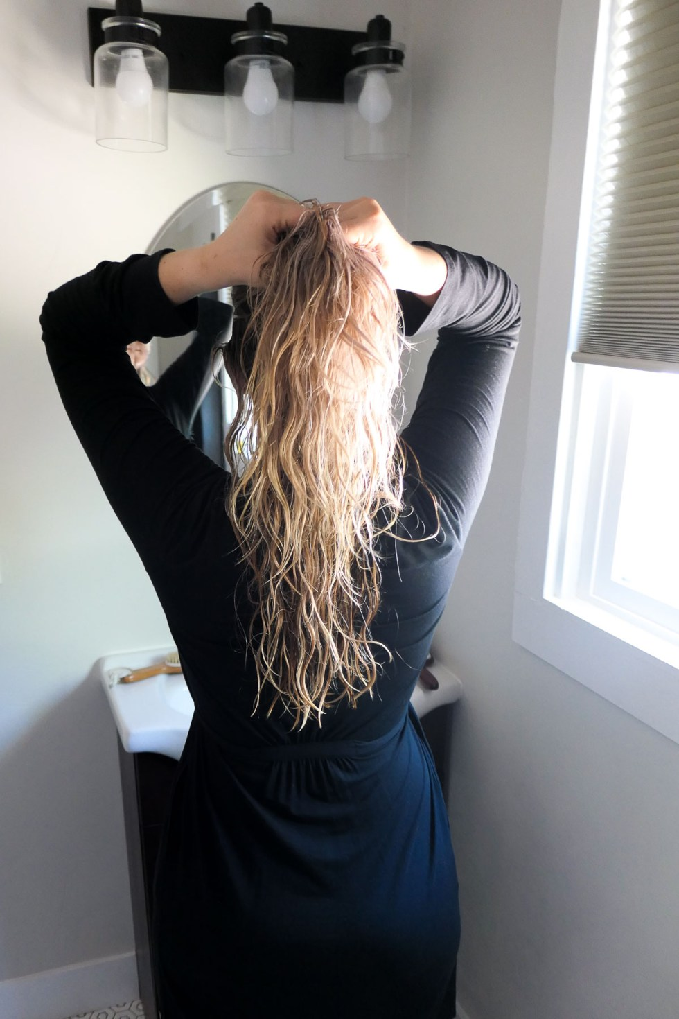Photo of woman with long blonde hair from behind. Do Shampoo Bar Really Work?