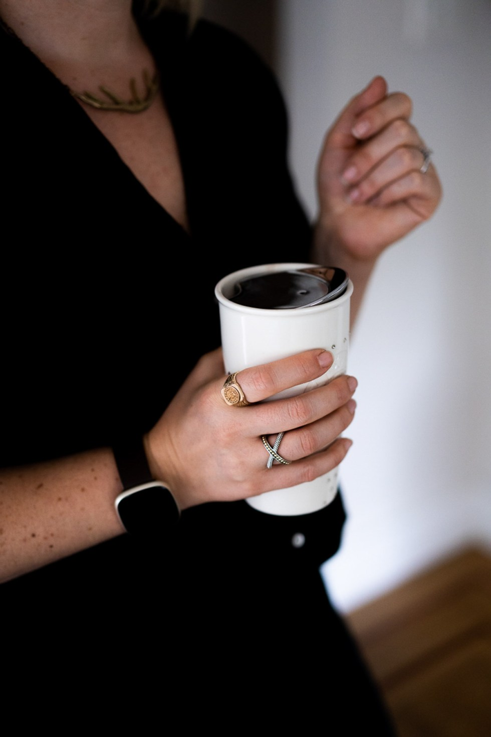 White Cup in Hand with LAGOS Ring