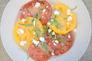 Heirloom Tomatoes with sea salt, cracked black pepper, fresh herb vinaigrette and crumbled Goat Lady chèvre