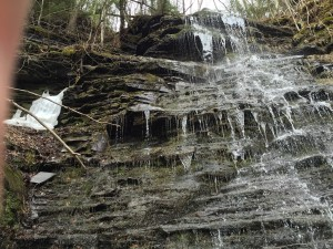 Waterfall with an ice block still visible.