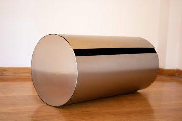 """Glimmer"". 2019. Aluminium, steel and black felt. 100.5 x 50.5 cm."