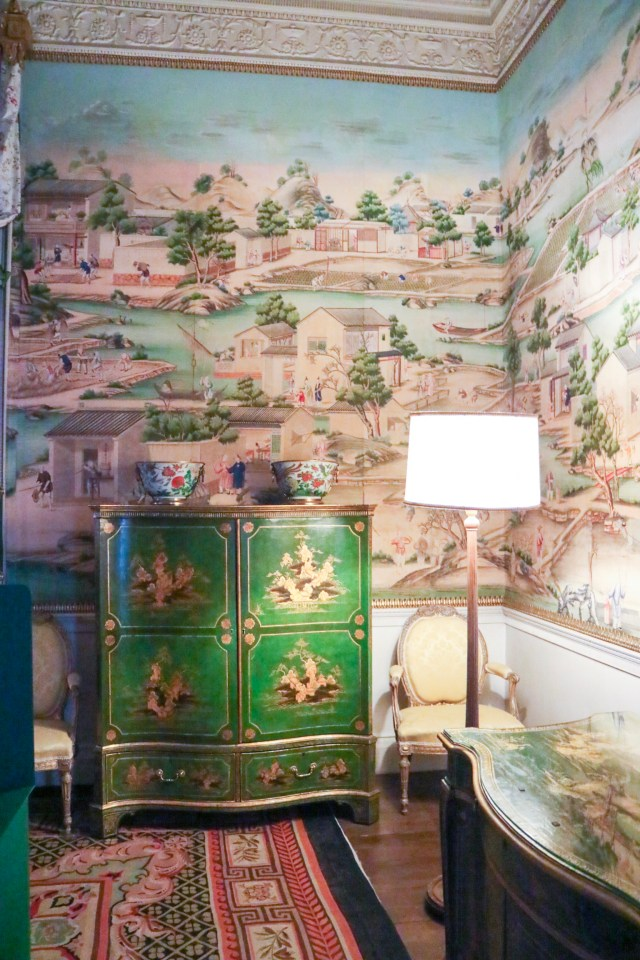wallpaper and dresser and lamp