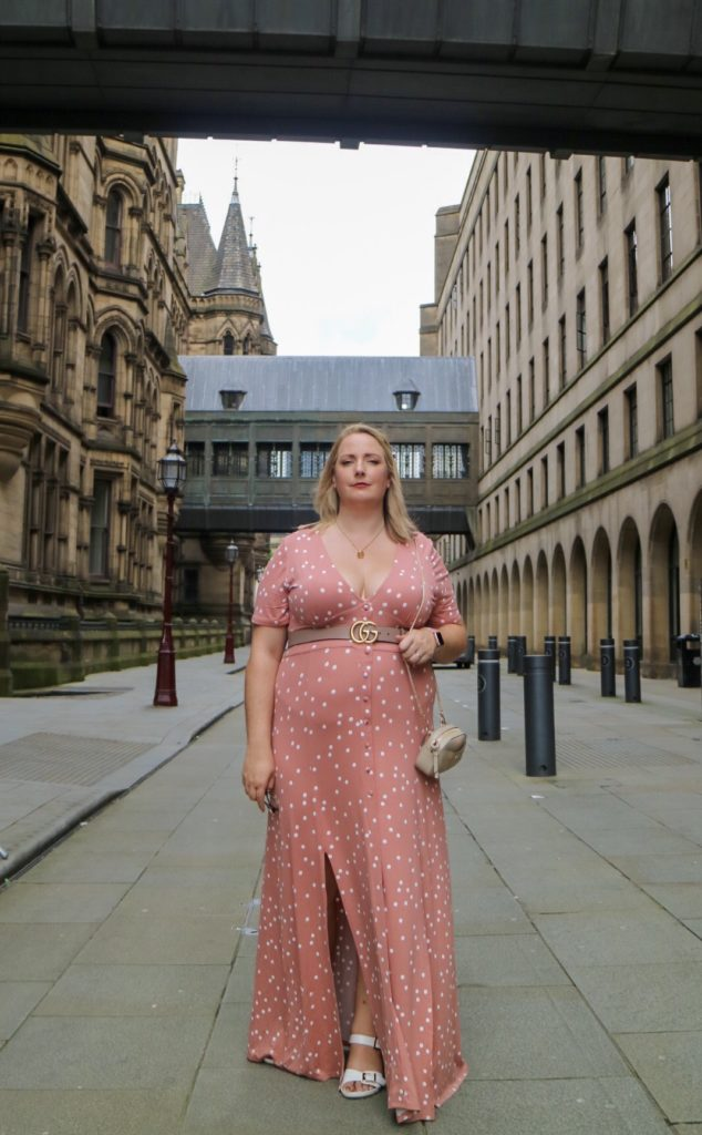 Lucy Stood near the manchester town hall in a long pink maxi dress and chloe bag