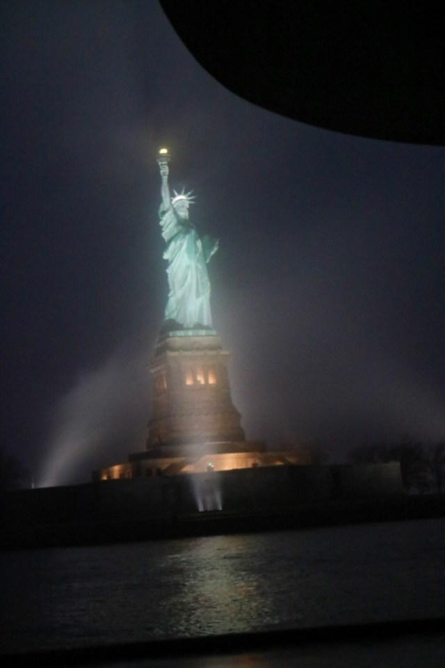 view of the Statue of Liberty on the fog from the boat