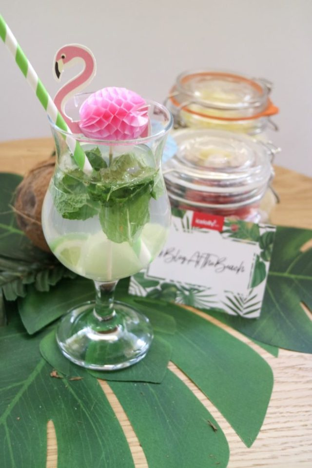 a mojito with flamingo decoration