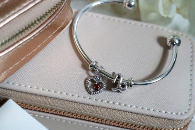 Pandora open bracelet with zodiac and birthstone charms