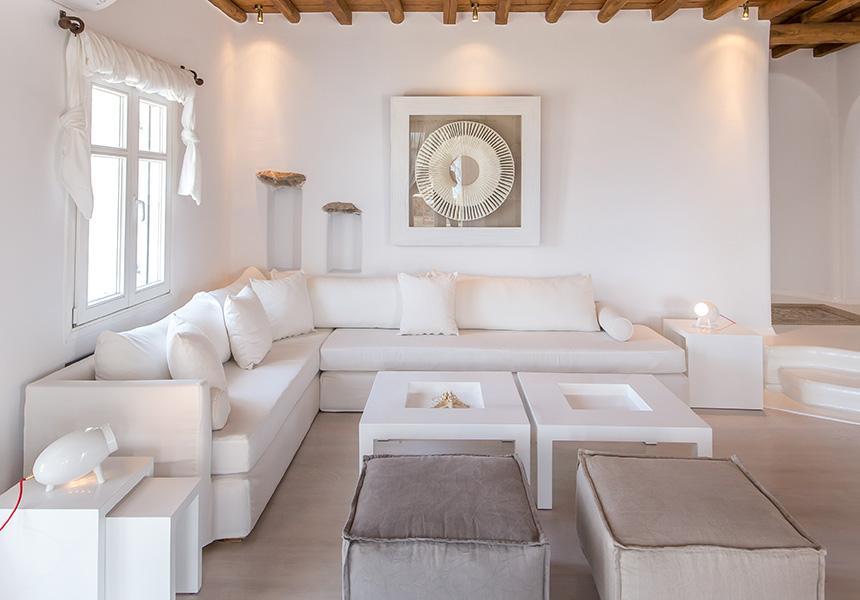 livingroom mykono villas, white sofa, coffe table, pouf