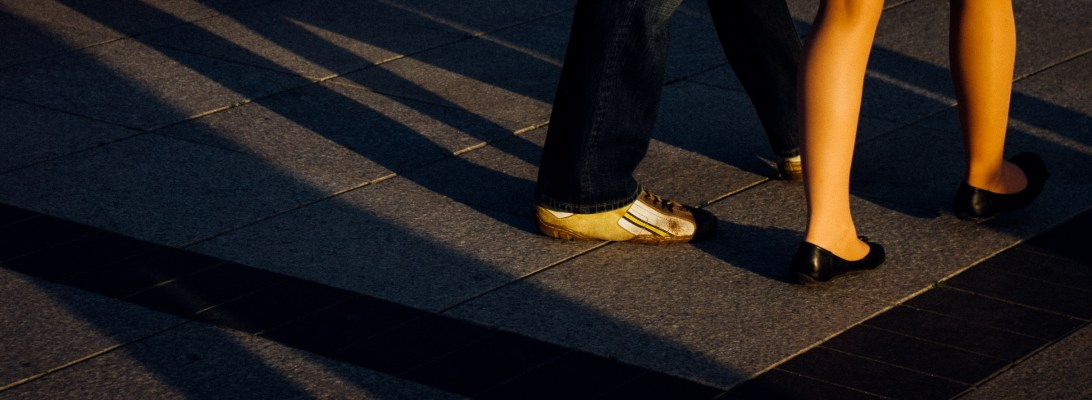 Detail of couple dancing Lindy Hop at the Cathedral Square, Vilnius, Lithuania. It was a lovely sunny afternoon.
