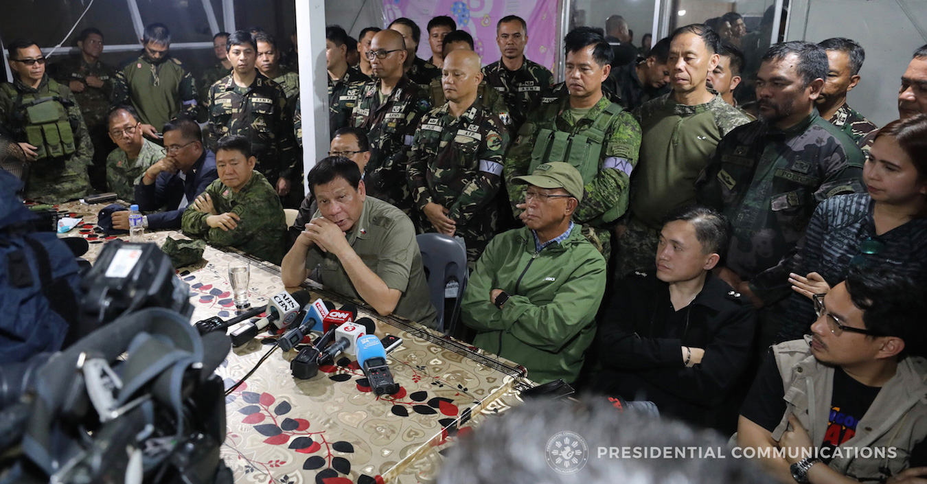 Duterte with soldiers in Marawi on martial law anniversary