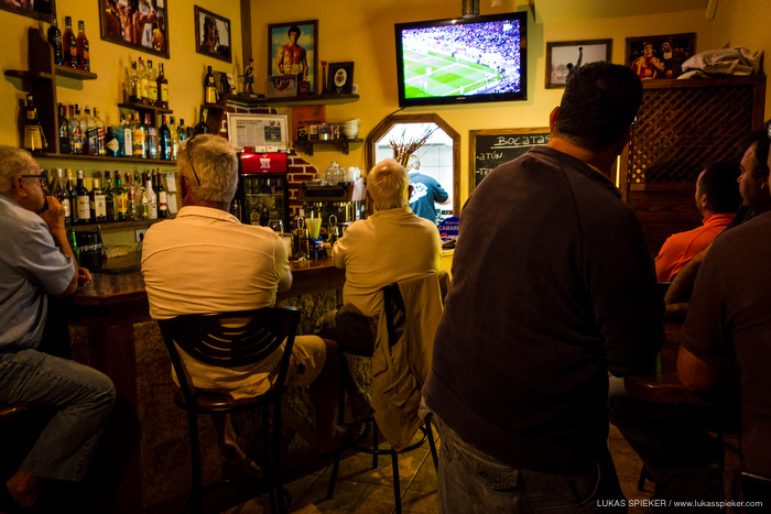 Locals are watching the Champions League football match between FC Barcelona and Paris Saint-Germain in a bar in El Cotillo, Spain April 10, 2013.
