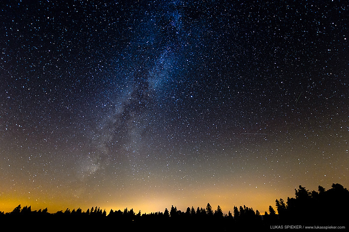 The Milky Way and two shooting stars (on the right) are pictured above a forest in Switzerland on August 15, 2013. The bright celestial body in the center of the photo is Vega,  the second brightest star in the northern celestial hemisphere.