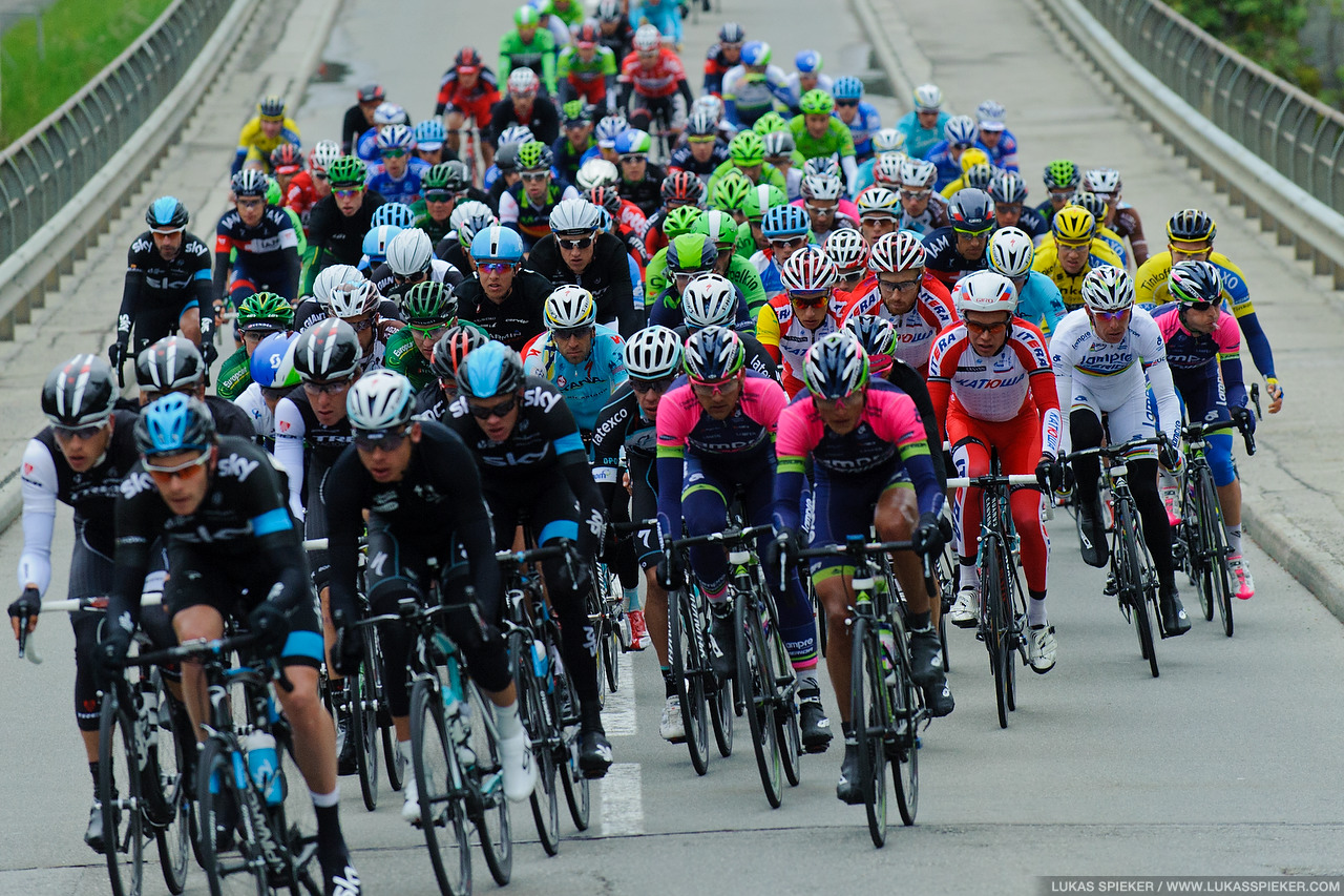 The peloton crosses the river Sarine in La Tuffiere during the 4th stage of the Tour de Romandie in Switzerland May 3, 2014.