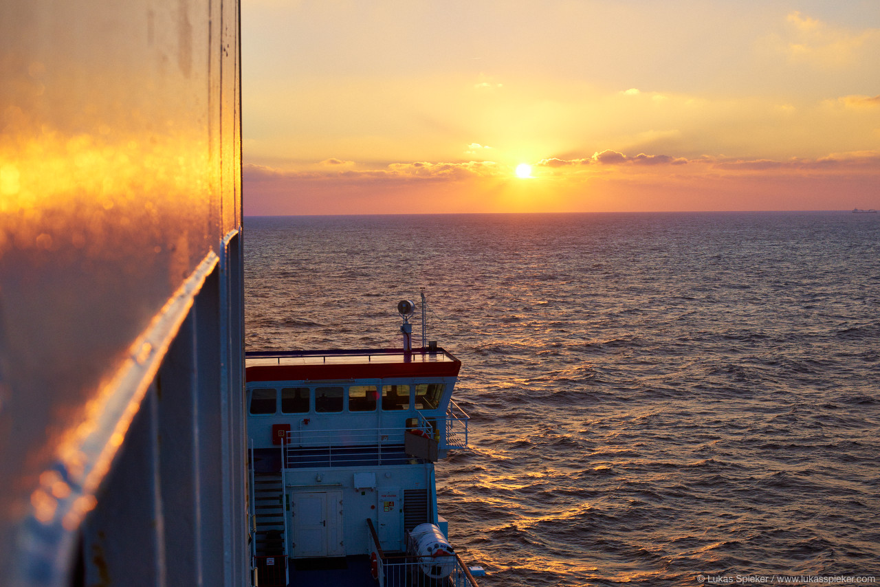 The sun rises as the ferry sails from Rosslare in Ireland to Cherbourg in France.