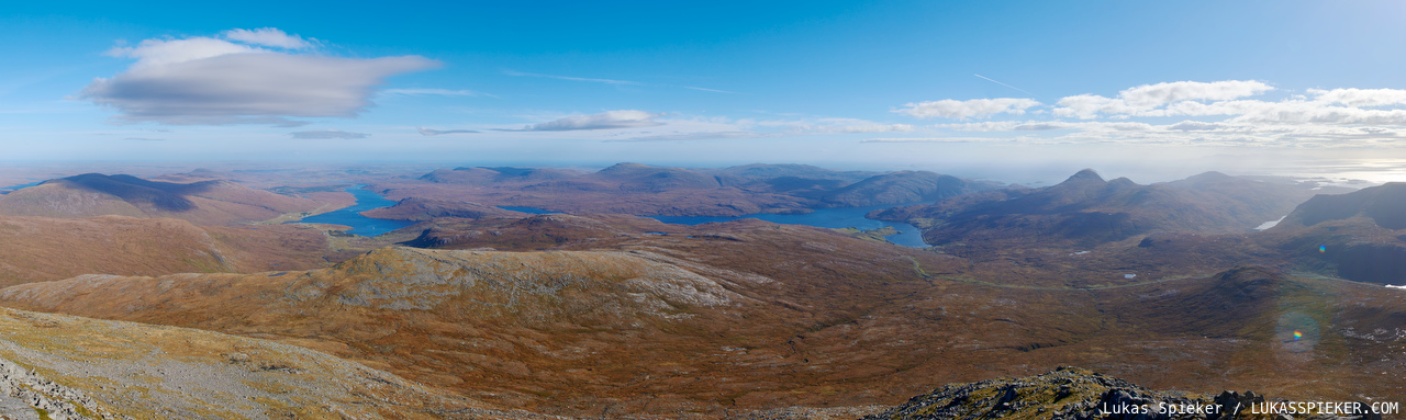 Panoramic view from Clisham on the Isle of Harris, highest mountain of the Outer Hebrides. Clisham is one of 221 Corbetts in Scotland – mountains that are between 2'500 and 3'000 feet high.