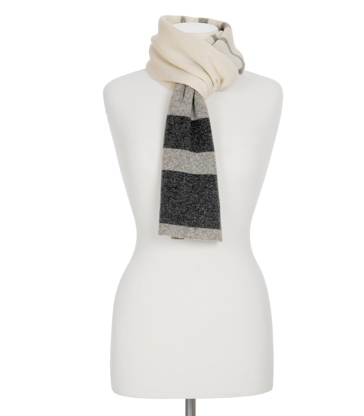 A grey and mahogany block striped faux fur scarf, on a white mannequin, on a white background.