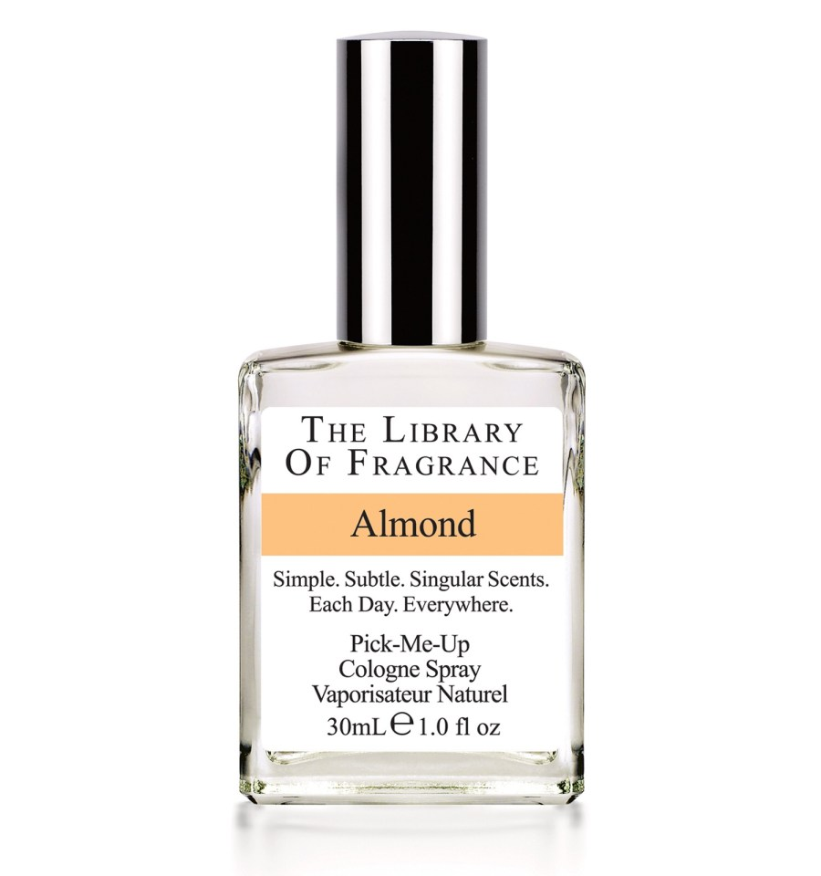 A clear glass perfume bottle with the library of fragrance written on a white label, and Almond written on a yellow strip, on a white background.