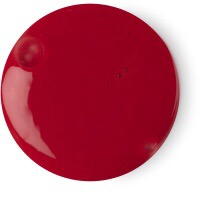 A circular pool of thick bright crimson red shower cream, on a white background.