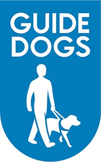 An elongated Sky Blue semi-circle that has a drawing of a white man, a white dog wearing a blue harness, and Guide Dogs written in capital bold white writing inside it, on a white background.