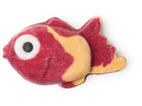 A bright pink and yellow chunky fish shaped bubble bar that has a white eye with a black pupil on it, on a white background.