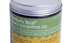 A short cylindrical black plastic tub with a silver lid and a green and yellow label that has berber's treat black eucalyptus cleansing gel written in bold white writing on it, on a white background.