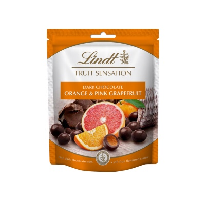 A rectangular white and orange plastic pouch that has Lindt Fruit Sensation written in cursive gold writing, Orange & Pink Grapefruit written in bold white writing, and a picture of some large oranges and some Pink grapefruits on it, on a white background.