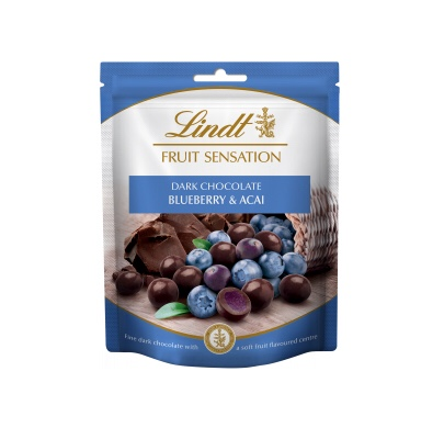 A rectangular blue and white plastic pouch that has Lindt Fruit Sensation written in cursive gold writing, Blueberry & Acai written in bold white writing, and a picture of some blueberries and some Acai Berries on it, on a white background.
