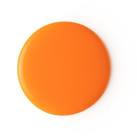 A large circular blob of dark Orange liquid, on a white background.