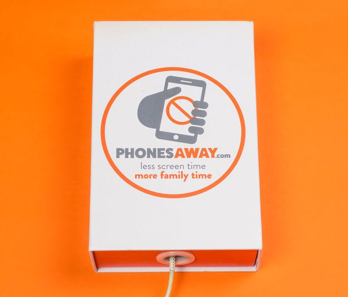 A short rectangular white box that has Phonesaway A Simple Solution To Reduce Your Screen Time written in bold grey writing and a picture of an orange warning sign on it, on a white background.