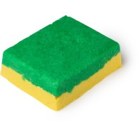 A large rectangular block of soap that has a green top layer and a yellow bottom layer, on a white background.