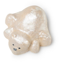 A large bright white polar bear shaped bubble bar that has some dark brown eyes embedded in it, on a white background.
