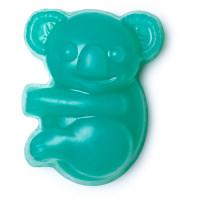 A small bright blue-green koala shaped block of soap, on a white background.