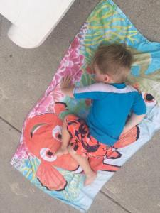 The other one who doesn't sleep when he's supposed to and takes a nap on the concrete AT THE POOL