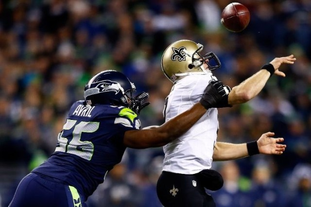 SEATTLE, WA - DECEMBER 02: Defensive end Cliff Avril #56 of the Seattle Seahawks knocks the ball from quarterback Drew Brees #9 of the New Orleans Saints in the first quarter during a game at CenturyLink Field on December 2, 2013 in Seattle, Washington. (Photo by Jonathan Ferrey/Getty Images)