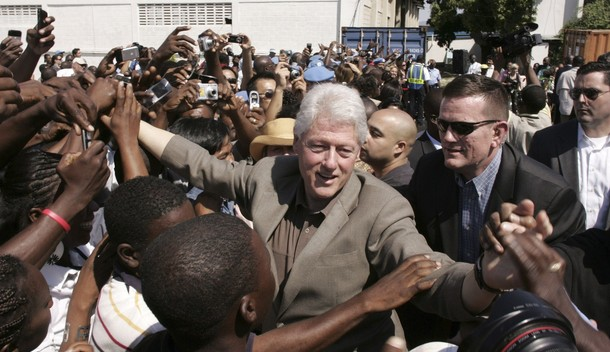 Former U.S. President Clinton greets Haitians during his visit to a U.N. base in Port-au-Prince