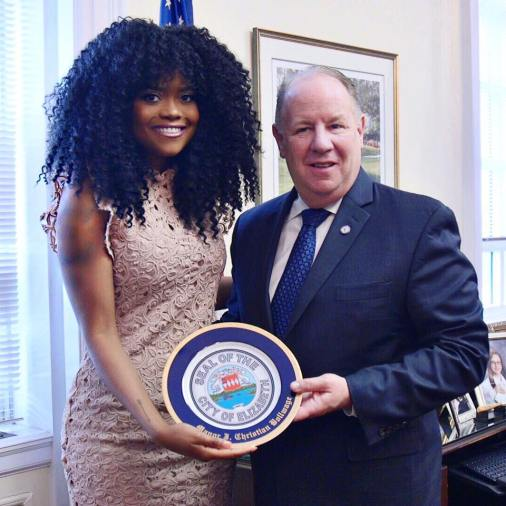 """Karen received the """"Seal Of The City Of Elizabeth"""" from Mayor Bollwage at City Hall."""