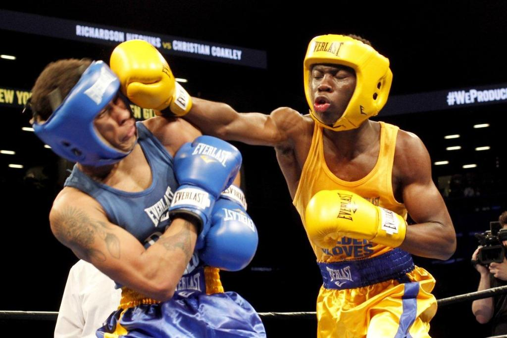 Richardson Hitchins (r.) slugs his opponent during a boxing match at the Barclays Center in Brooklyn in April. (KEN GOLDFIELD FOR NEW YORK DAILY NEWS)