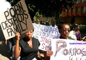 ACTIVISTS against pornography marching along church road in Lusaka carrying placards