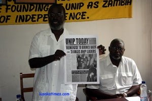 UNIP president Tilyenji Kaunda with his deputy Njekwa Anamela (r) lauching the party's publication in Lusaka recently