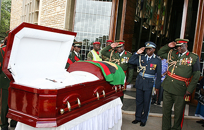 Zambia Army officers salute the late Gwendoline Konie after the requieme mass in Lusaka
